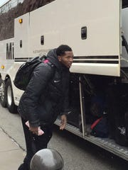 Tyler Wideman gets ready to board the bus at the Hinkle Fieldhouse parking lot.