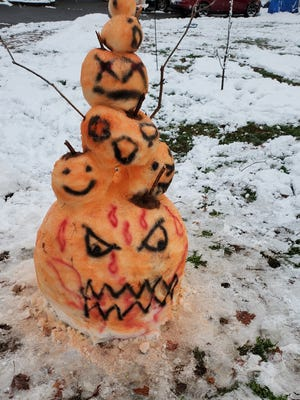 A Taunton resident gets creative with a colorful pumpkin snowman  Friday, Oct. 30, 2020.