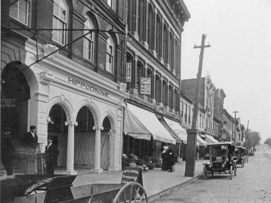 Here are some Ford Model T's parked by the Hippodrome on West Main Street in 1900. Check out the tires on the cars, which were not much wider than the wooden wheel on the horse-drawn wagon in the lower left.