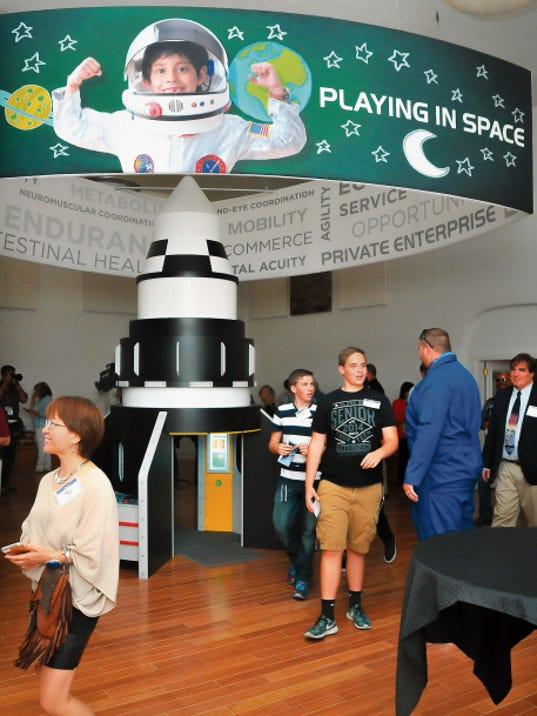 People tour the Spaceport America tour and visitor center in Truth or Consequences on Wednesday. The center, located in a former senior citizen activities building, is planned as a gateway to Spaceport America, the world's first purpose-built, commercial spaceport.