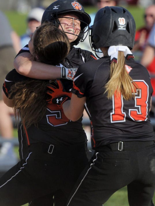 Central York High School's Kayla Resh is mobbed by teammates after her game-winning hit in the bottom of the seventh inning against Dallastown. The Panthers' 5-4 win over the Wildcats granted Central the 2015 YAIAA Division I championship.