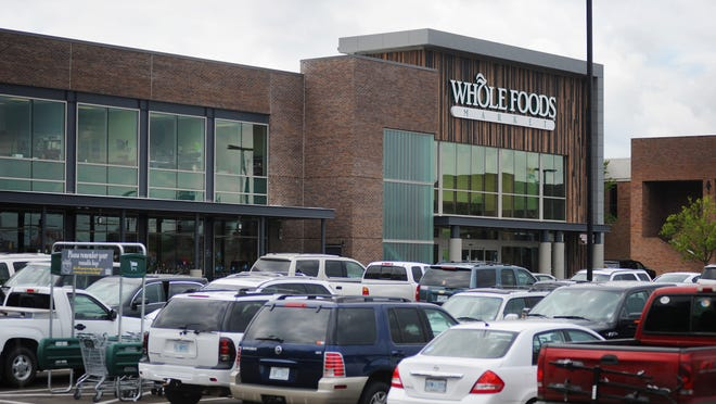 A fight over a proposed parking lot across from the new Whole Foods Market at Highland Village in Jackson is now in court.