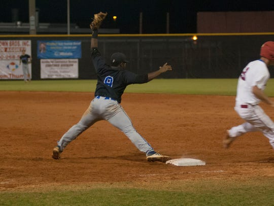 Washington's TJ Hardeman stretches to complete a double