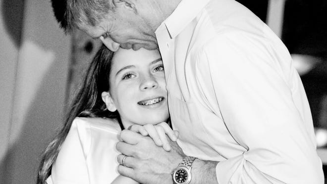 Sophie Roth-Douquet dancing with her father, Greg, in May 2011.