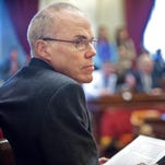 Climate change expert Bill McKibben prepares to speak to legislators and members of the public in the House chamber at the Statehouse in Montpelier in January 2012.