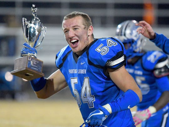 Robert E. Lee's Dylan Culpen holds up the VHSL Class 2, Region B championship trophy after the Leemen defeated Luray on Nov. 24 in Staunton. Culpen will continue his academic and athletic career at Frostburg State (Md.) University in the fall.