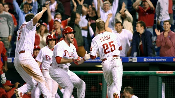 Phillies third baseman Cody Asche (25) celebrates with