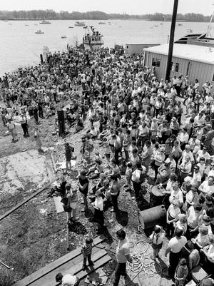 Thousands of spectators gather on shore and in boats on the Ohio River for the launch of the Opryland new 300-foot-long Victorian showboat, the General Jackson, in Jeffersonville, Ind. April 20, 1985.