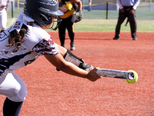 Lady Cat Mireya Trujillo laid down a bunt single Tuesday to help defeat visiting Alamogordo 10-6 in game one of a district double-header.