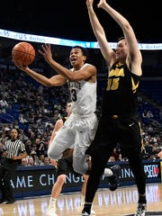 Penn State guard Rasir Bolton (13) shoots past Iowa forward Ryan Kriener (15) during the first half of an NCAA college basketball game Wednesday, Jan. 16, 2019, in State College, Pa. (AP Photo/John Beale)