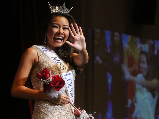 Justine Ker waves after winning the title Miss Louisiana