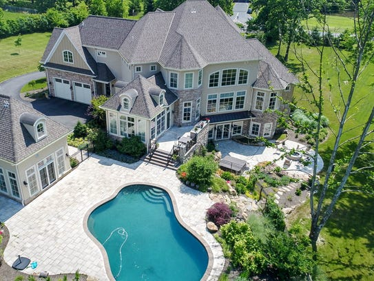 Outside there's a custom-shaped pool and hot tub, outdoor