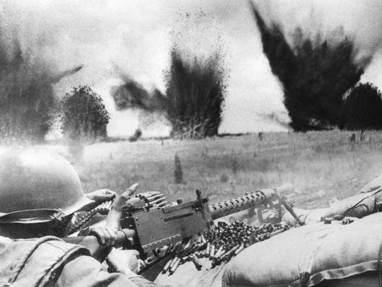 U.S. Air Force bombs create a curtain of flying shrapnel and debris barely 200 feet beyond the perimeter of South Vietnamese ranger positions defending Khe Sanh during the siege of the U.S. Marine base in March 1968.