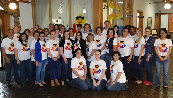Gulf Coast Bank staff sport duck T-shirts for the Boys and Girls Clubs annual fundraiser.