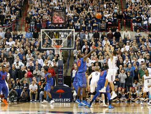 Dec 2, 2013; Storrs, CT, USA; Connecticut Huskies guard Shabazz Napier (13) shoots a three point shot in the last seconds of play against the Florida Gators in the second half at Harry A. Gampel Pavilion. UConn defeated Florida Gators 65-64.  Mandato