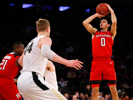 Rutgers Scarlet Knights guard Geo Baker (0) shoots over Purdue Boilermakers center Isaac Haas (44) in the 2018 Big Ten Tournament at Madison Square Garden