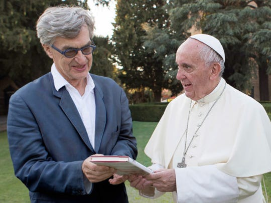"The pope, right, director Wim Wenders team up for the documentary ""Pope Francis: A Man of His Word."""