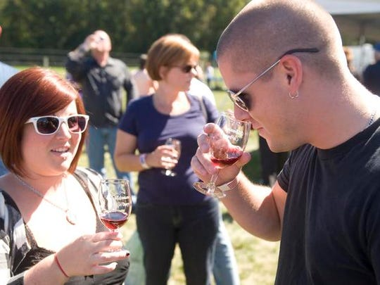 Guests sample wines at a past Wine Fest at Valenzano Winery.