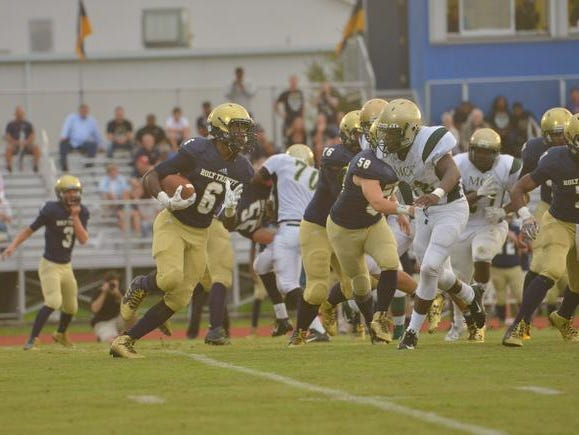 Jashaun Corbin carries the ball in Holy Trinity's game against Melbourne Central Catholic.