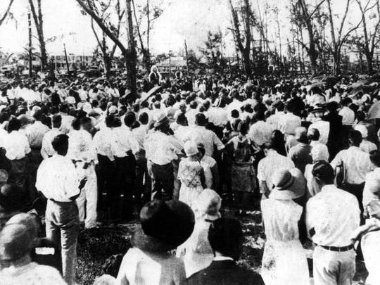 A funeral service for the victims of the 1928 hurricane in West Palm Beach.
