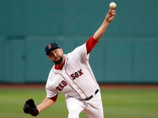 Boston Red Sox starting pitcher Brian Johnson (61) delivers against the Los Angeles Angels during the first inning at Fenway Park.