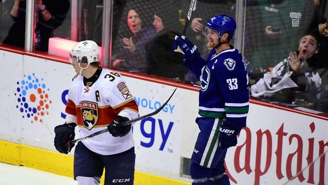 Canucks forward Henrik Sedin (33) celebrates his goal, which marked his 1,000th career point.