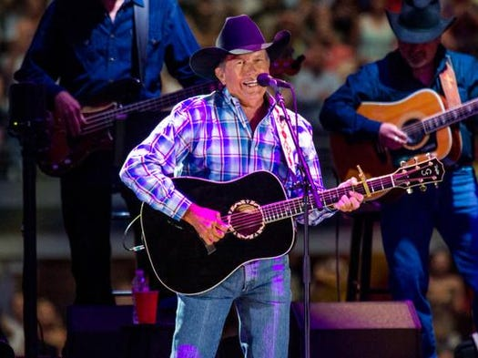 George Strait performs during his farewell tour at AT&T Stadium in Arlington, Texas, on Saturday, June 7, 2014. About 105,000 people packed in for the last concert of Strait's final tour.