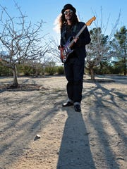 Brant Bjork of Brant Bjork & the Low Desert Punk Band stands in the backyard of his Joshua Tree, Calif. home on January 13, 2015. Bjork, who was raised in the Coachella Valley, was the original drummer of the band Kyuss. Now he's on the 2015 Coachella Valley Music and Arts Festival lineup.