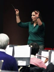 Members of the Raritan Valley Symphonic Band rehearse