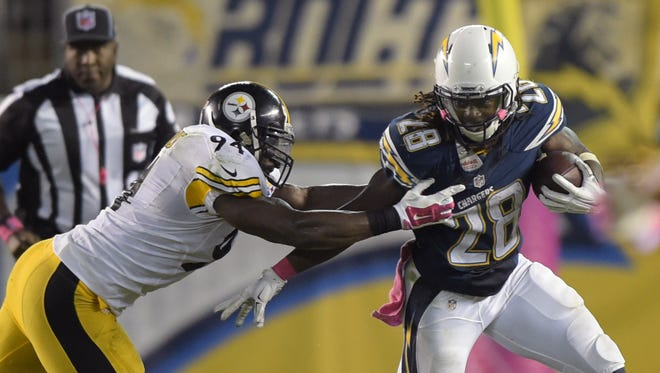 San Deigo Chargers running back Melvin Gordon (26) is defended by Pittsburgh Steelers linebacker Lawrence Timmons (94) at Qualcomm Stadium.