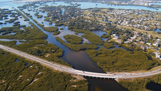 Florida's mash lands must co-exist with the building and population growth in the Sunshine State