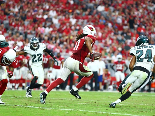 Larry Fitzgerald scores against the Eagles on Oct. 26, 2014.