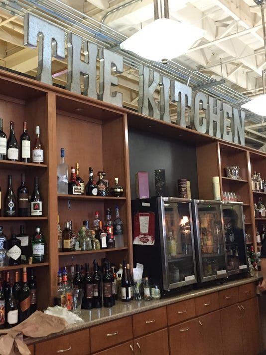 635800025952956899-The-Kitchen-sign-and-wine