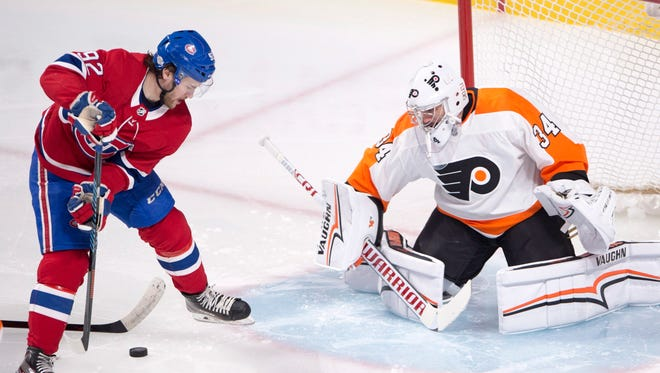Jonathan Drouin tries a between the leg shot on Flyers goaltender Petr Mrazek during the second period Monday in Montreal.