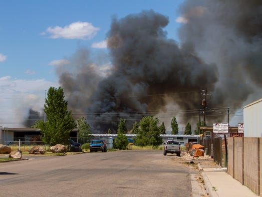 A fire burns along Coal Creek Road in Cedar City, June