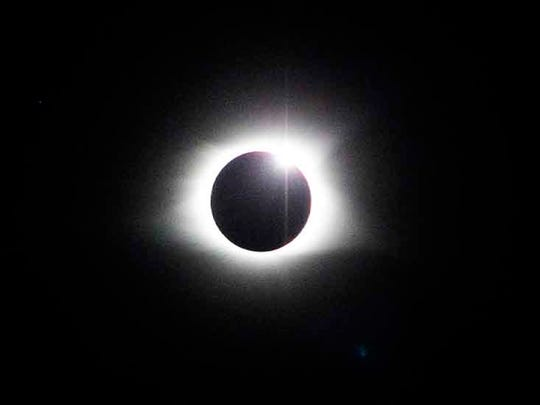 The eclipse reaches totality in Great Smoky Mountains National Park at Clingman's Dome Tuesday, Aug. 21, 2017.