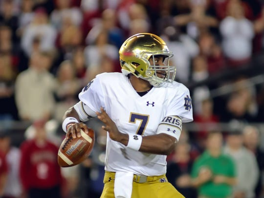 Notre Dame Fighting Irish quarterback Brandon Wimbush (7) drops back to pass during the first quarter against the Stanford Cardinal at Stanford Stadium.