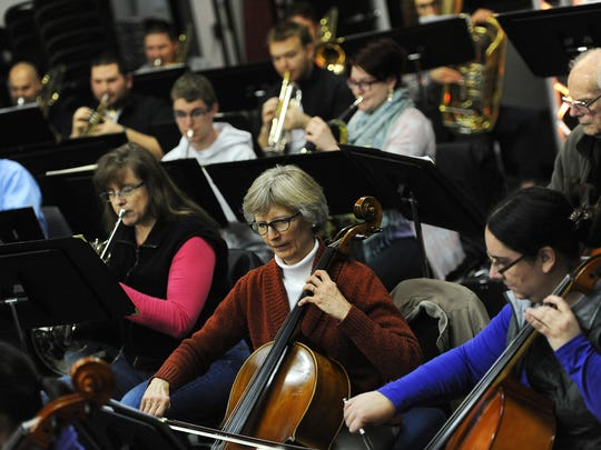 The Reno Pops Orchestra , including Priscilla Mills on cello, middle, rehearses on Jan. 8 at JamPro Music Factory for an upcoming fundraiser. The Reno Pops will play Poppin' Pistons at 6 p.m. Jan. 31 at the National Automobile Museum.
