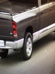 This image provided by the Livingston Parish Sheriff's Office on Saturday, Jan. 26 shows a 2004 Dodge pickup truck, gray on top, silver on bottom, 4 door, license plate C583809 driven by shooting suspect Dakota Theriot, 21. Authorities in Louisiana say separate but related shootings in two different parishes have left five people dead. Theriot was at large and was being sought.