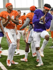 Clemson wide receiver Diondre Overton (14) and quarterback Kelly Bryant(2) before stretching during football practice in Clemson on Wednesday.