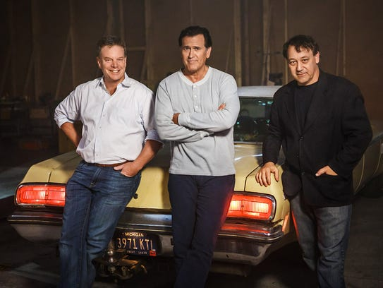 "Rob Tapert, left, Bruce Campbell and Sam Raimi of ""The"