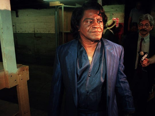 In 1997, James Brown frowns as he tours King Records