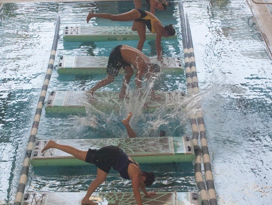 A water yoga class is shown at the LifeTime Athletic