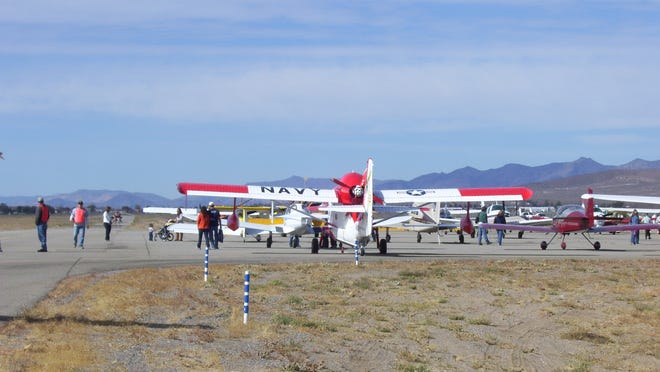 Airplanes arrive on the airfield to take part in a Lyon County Fly-In at the Silver Springs Airport.