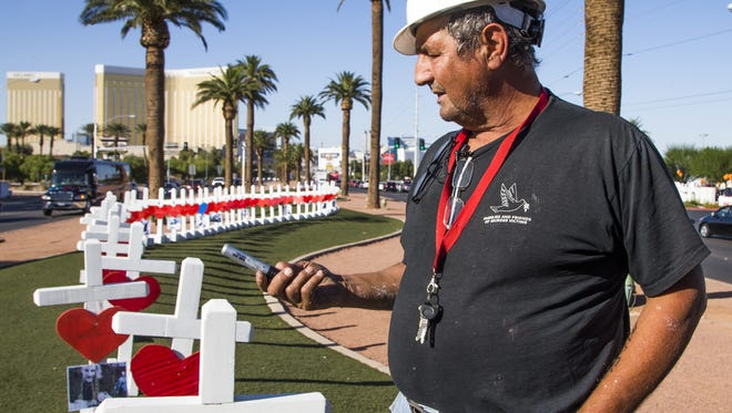 Artist Greg Zanis of Aurora, Illinois, constructed 58 crosses and drove across the country, arriving in Las Vegas Thursday afternoon, Oct. 5, 2017, to install them on Las Vegas Blvd to honor the people killed in the mass shooting.  Zanis said he has created crosses for many of the recent national tragedies, Newtown, San Bernardino and now Las Vegas. Mandalay Bay is in the background.