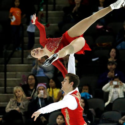 Haven Denney and Brandon Frazier compete in the pairs short program at Skate America in Hoffman Estates, Ill.