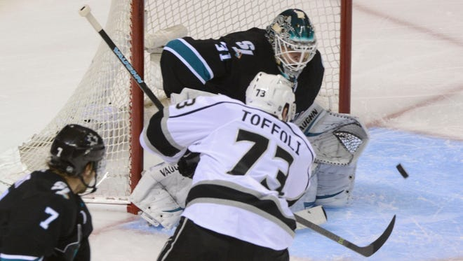 Los Angeles Kings center Tyler Toffoli scores a goal against San Jose Sharks goalie Antti Niemi during the third period in Game 7 of the first round.