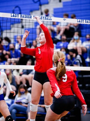 Glen Rose setter Emma Lozier dumps a ball over the net during action against Lampasas on Tuesday night.