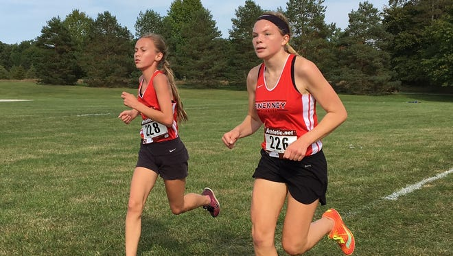 Noelle Adriaens (right) was fifth and Vivi Eddings (left) was sixth for Pinckney in the Holly/Duane Raffin Festival of Races.