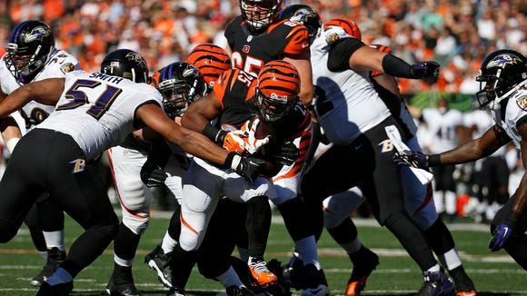 Bengals running back Giovani Bernard carries the ball against the Ravens.